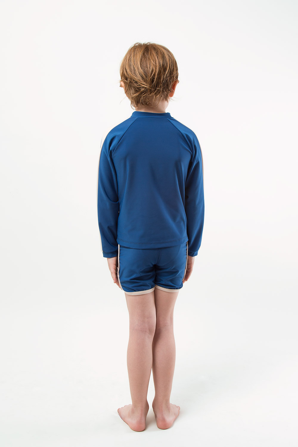 eco friendly rash guard and short blue. Front zipper, boy view