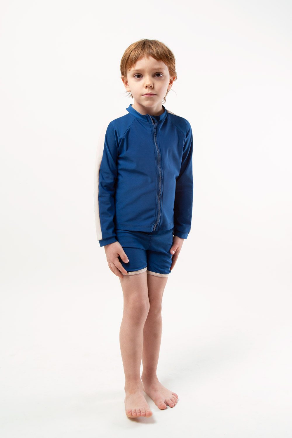 eco friendly rash guard blue. Front zipper, boy view